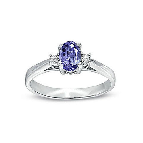 0-53cttw Tanzanite and Diamond Ring set in 14k gold