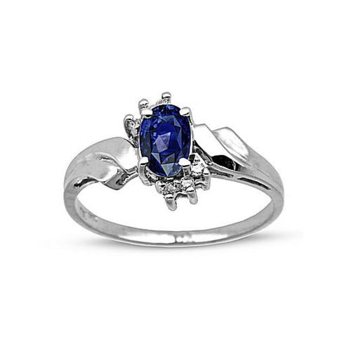 0-60cttw-sapphire-and-diamond-fashion-ring-set-in-14k-gold