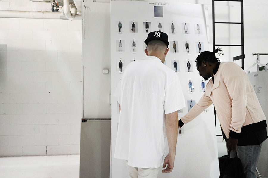 John Elliott and Pusha T goes through the outfits for the show.