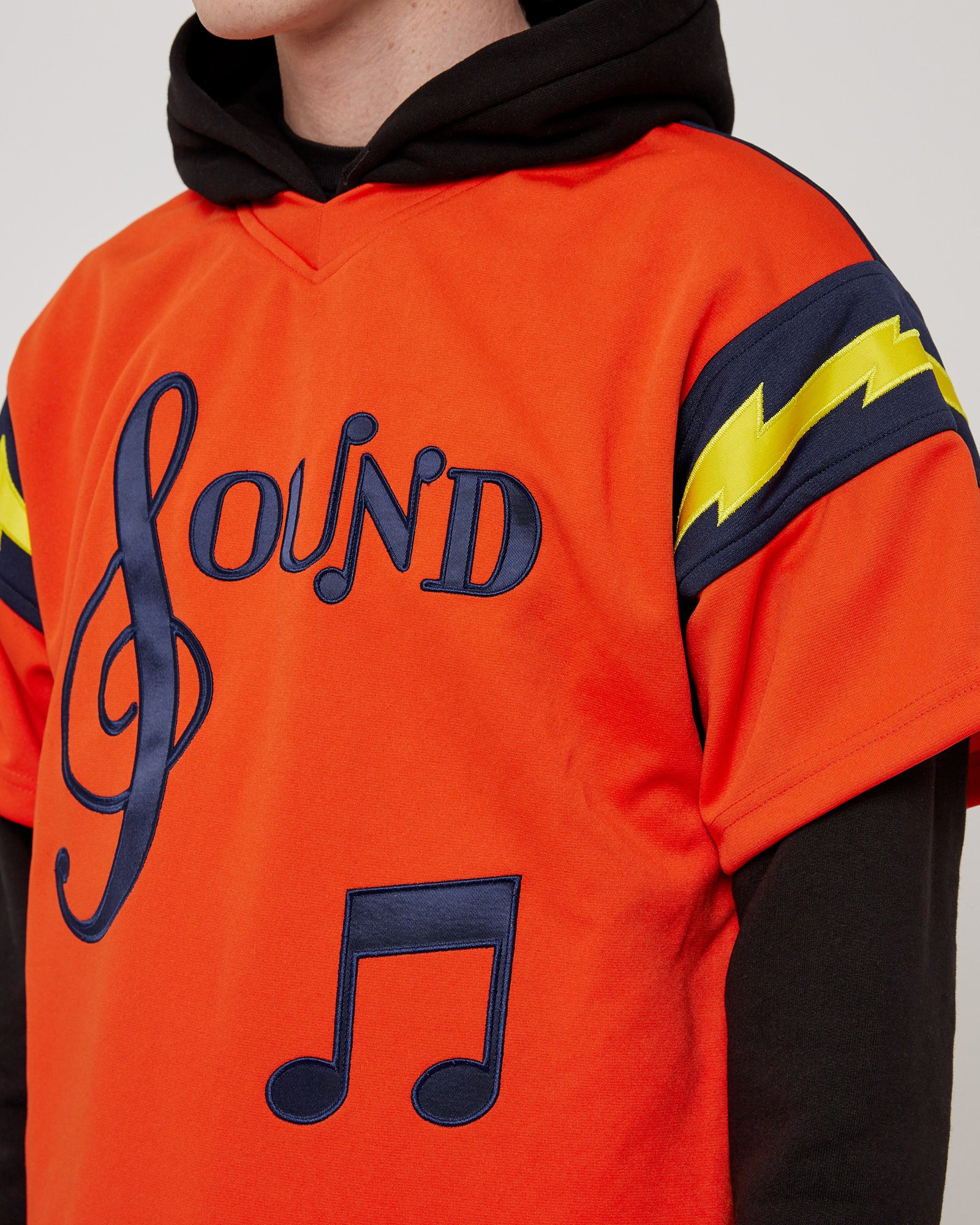The Sound Football Jersey Hoodie in Orange