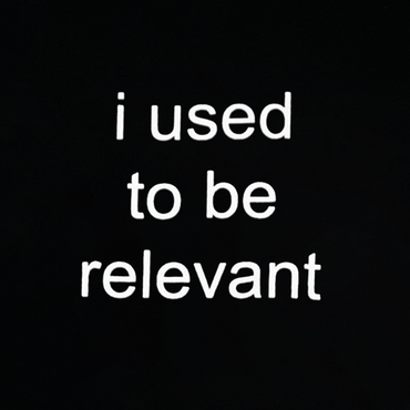 I USED TO BE RELEVANT T-SHIRT (BLACK)