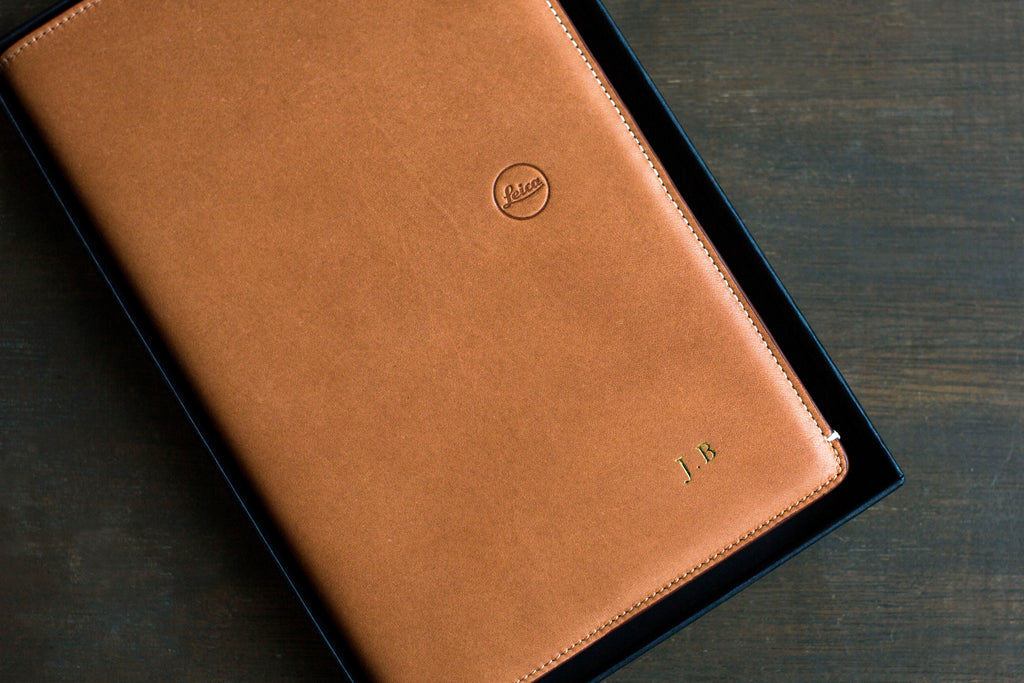 Gold foil initials stamping on leather notebook