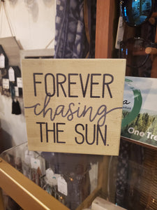 """Forever Chasing the Sun"" sign"