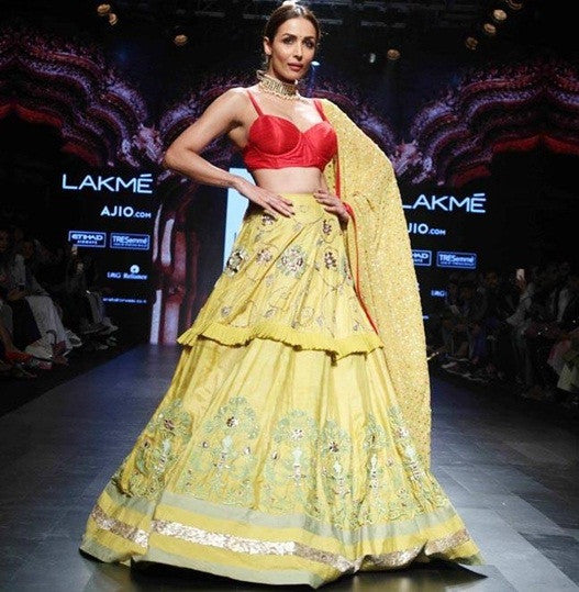 Red Choli And An Embellished Yellow Layered Lehenga