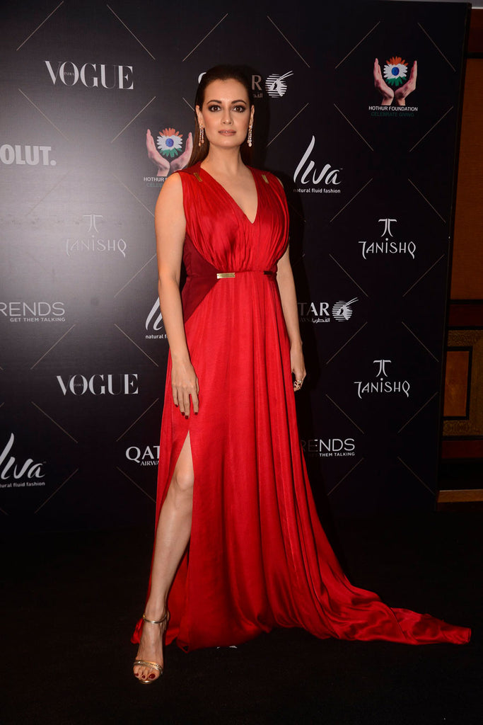 Dia Mirza stopped by in a sexy, red Grecian number by Nikhil Thampi.