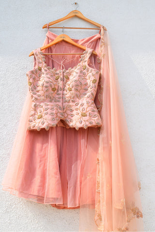 Salmon Rose Gold Zardozi Peplum Blouse With Salmon Lehenga & Cutwork Dupatta FRONT