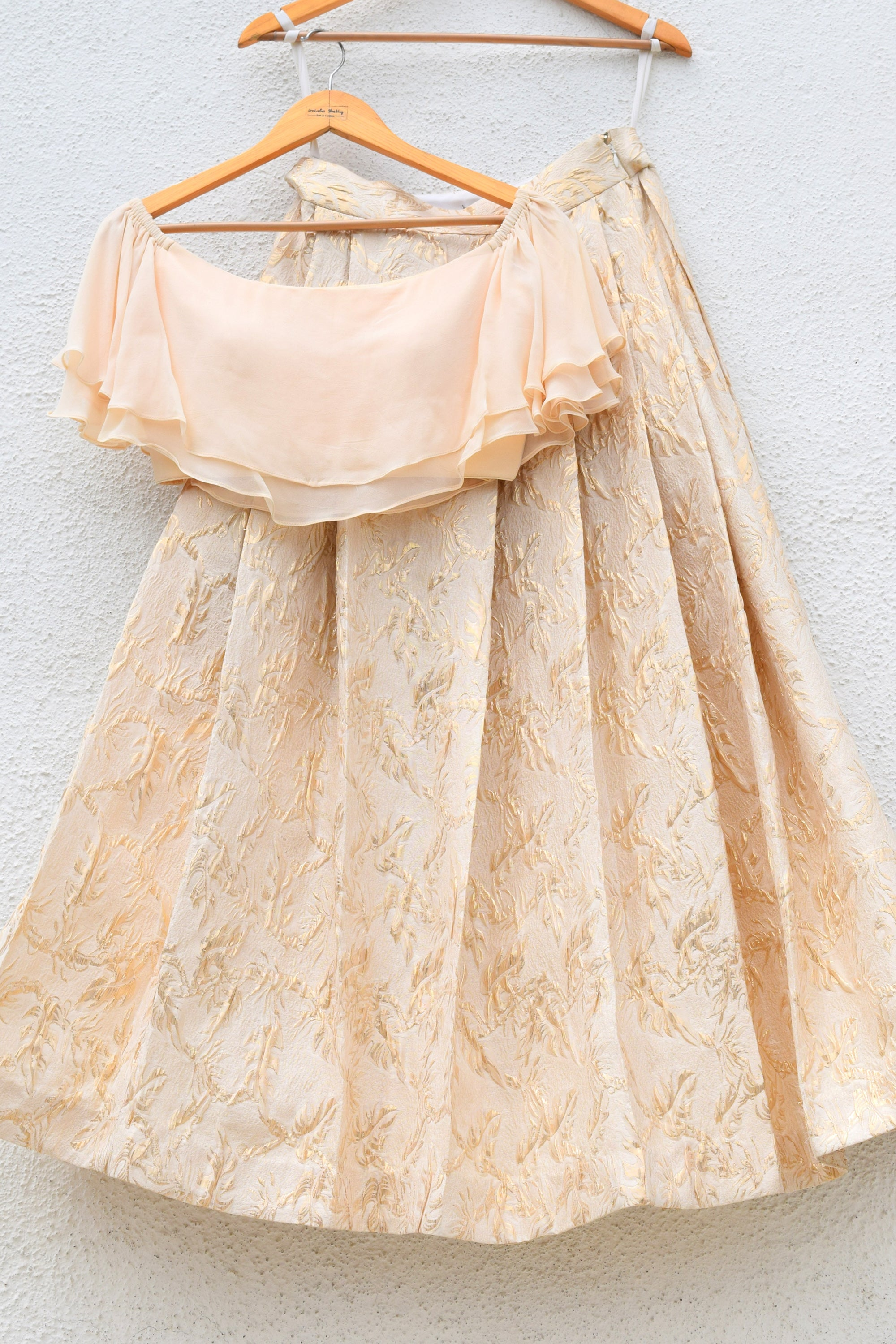 Jacquard Brocade Lehenga With Offshoulder Cascade Frills Crop Top