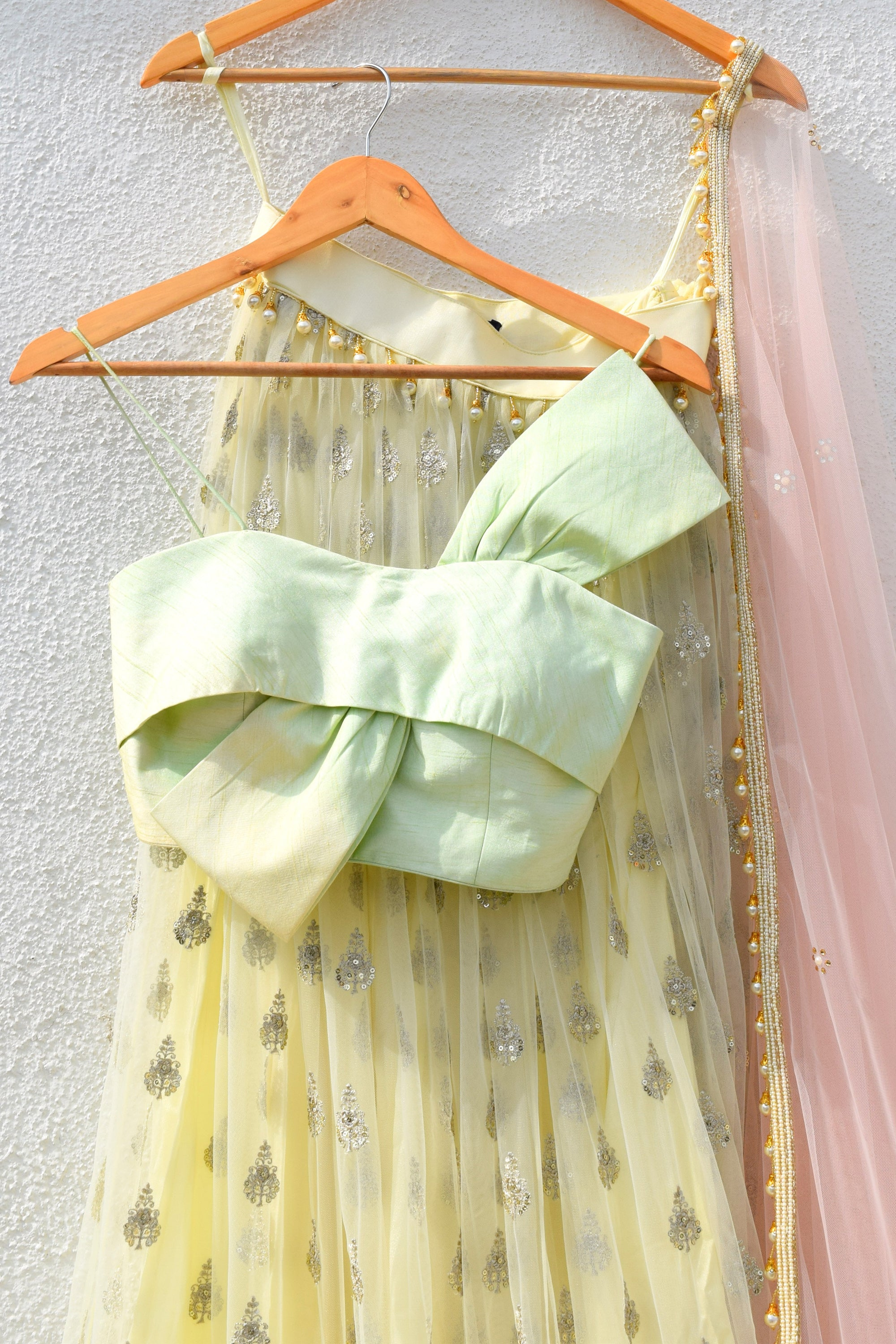 Banana Yellow Lehenga With Mint Green Bow Blouse & Cotton Candy Pink Dupatta CloseUp