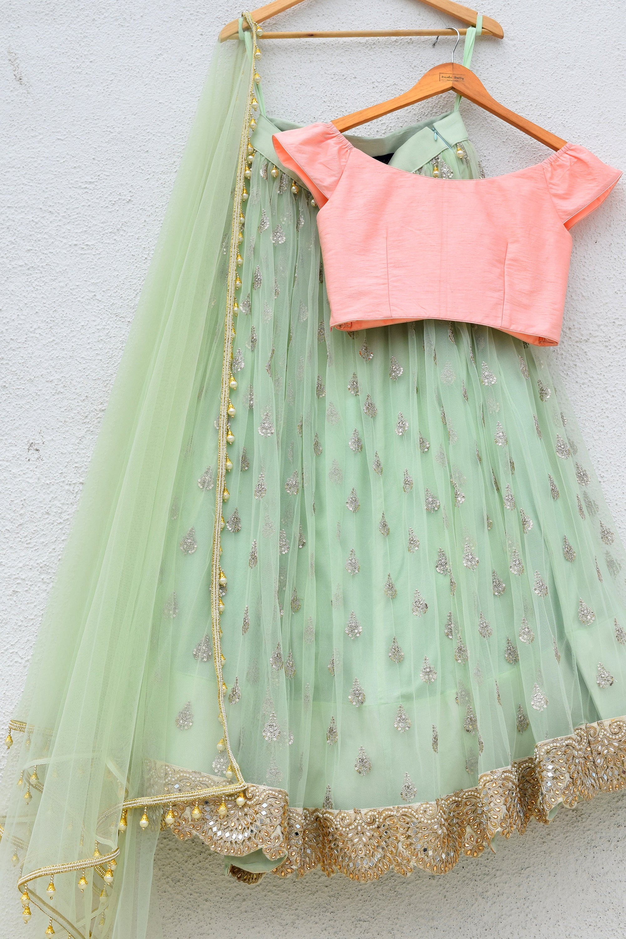 Mint Green Lehenga With Peach Pink Blouse Back