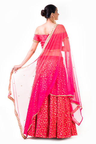 Tomato Peach Lehenga With An Off-Shoulder Silk Blouse