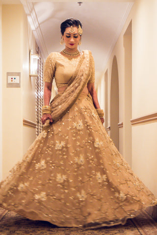 Raw Silk Gold Blouse With Gold Embroidered Net Lehenga Set