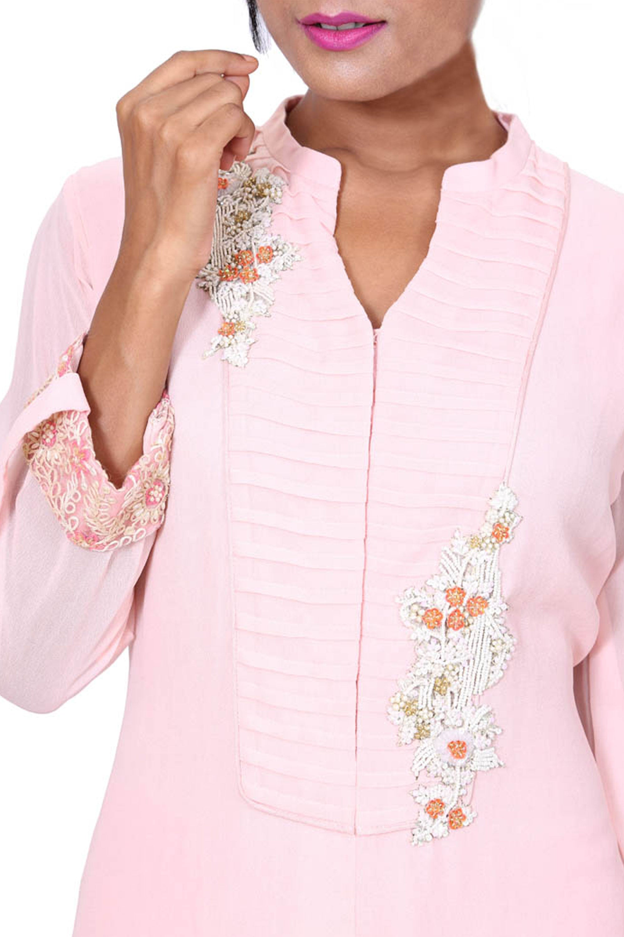 Long Baby Pink Tunic With Embroidered Hemline Closeup