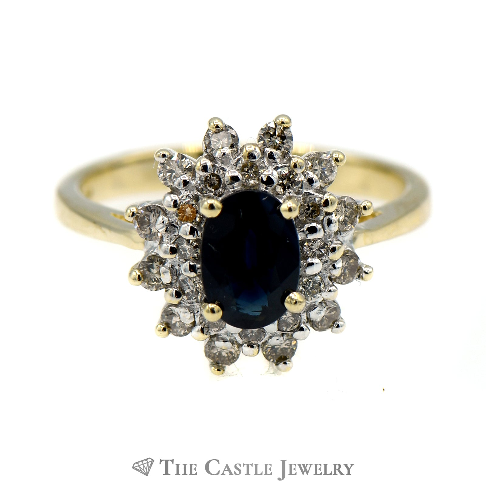 Dark Blue Sapphire Ring Surrounded by Layered Diamond Halo