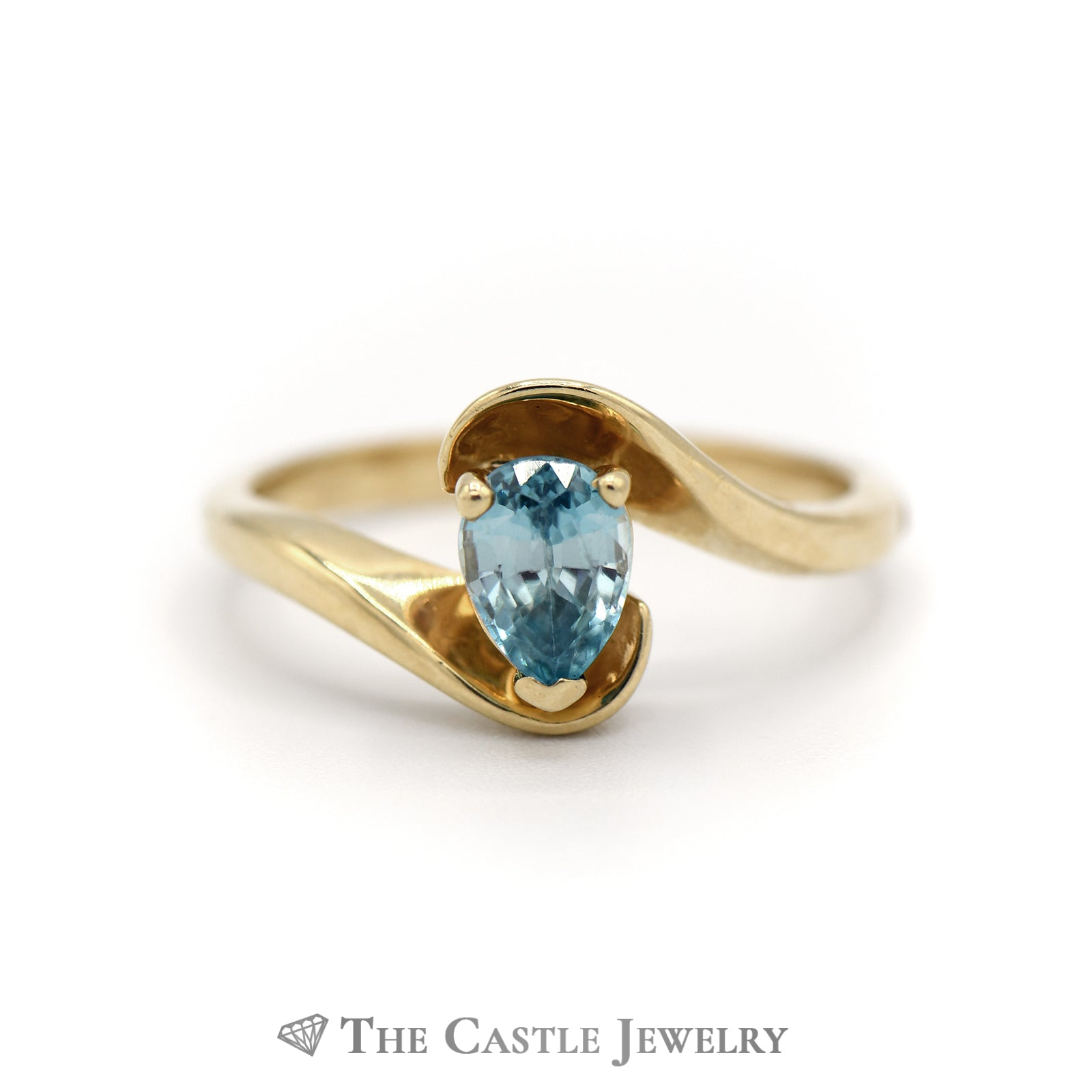 Pear Shape Blue Topaz Ring in Bypass Designed Mount