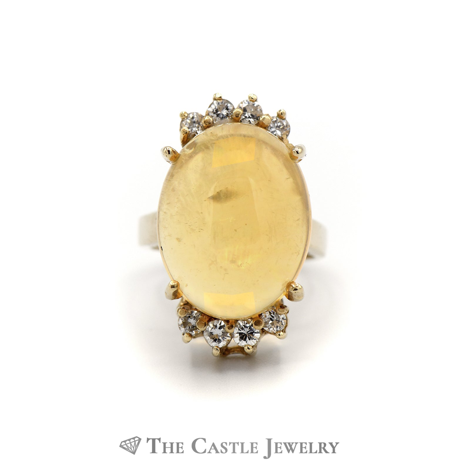 Beautiful Oval Yellow Jelly Opal with Round Diamond Accents in 14K Yellow Gold
