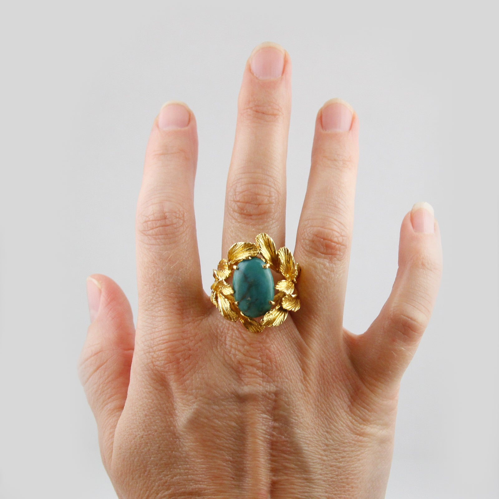 Oval Turquoise Ring with Etched Leaf Design Mounting Crafted in 18k Yellow Gold
