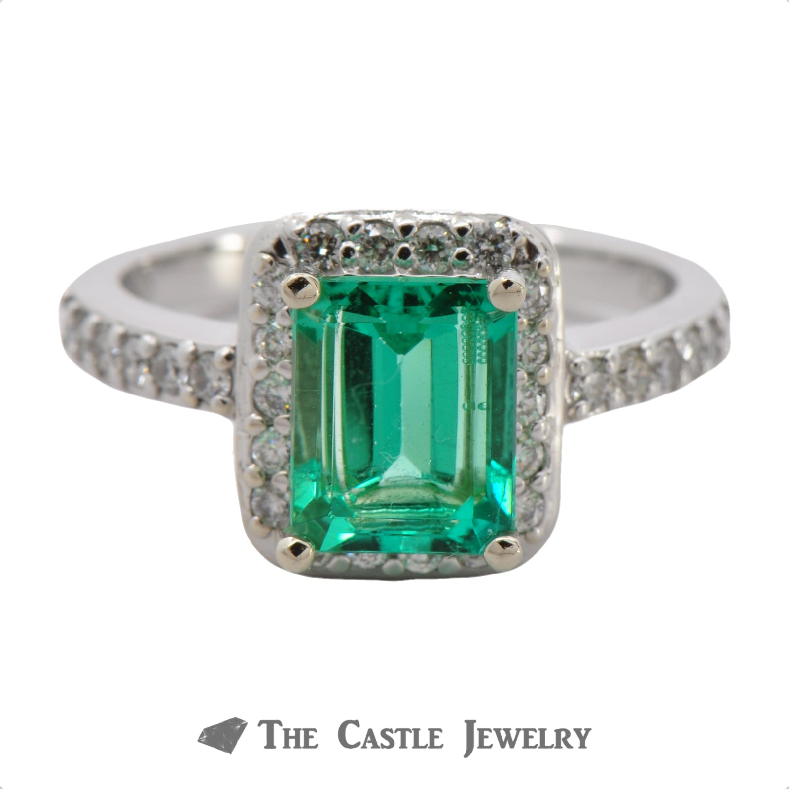 Stunning Emerald Cut Emerald with a Diamond Halo in 14K White Gold