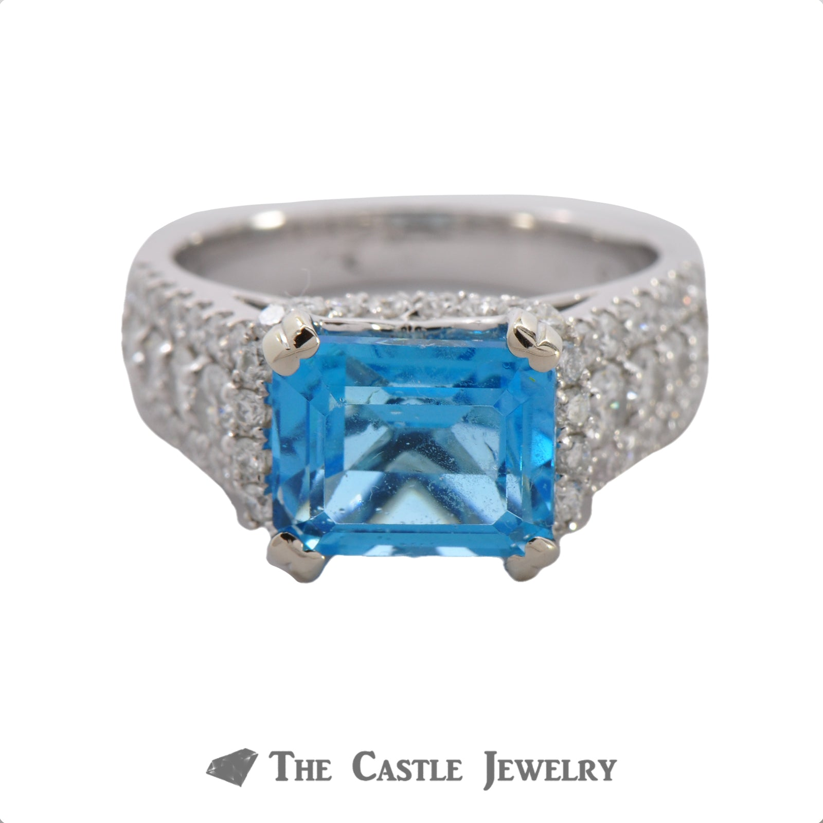 Side Set Emerald Cut Blue Topaz Ring in Diamond Encrusted Mounting