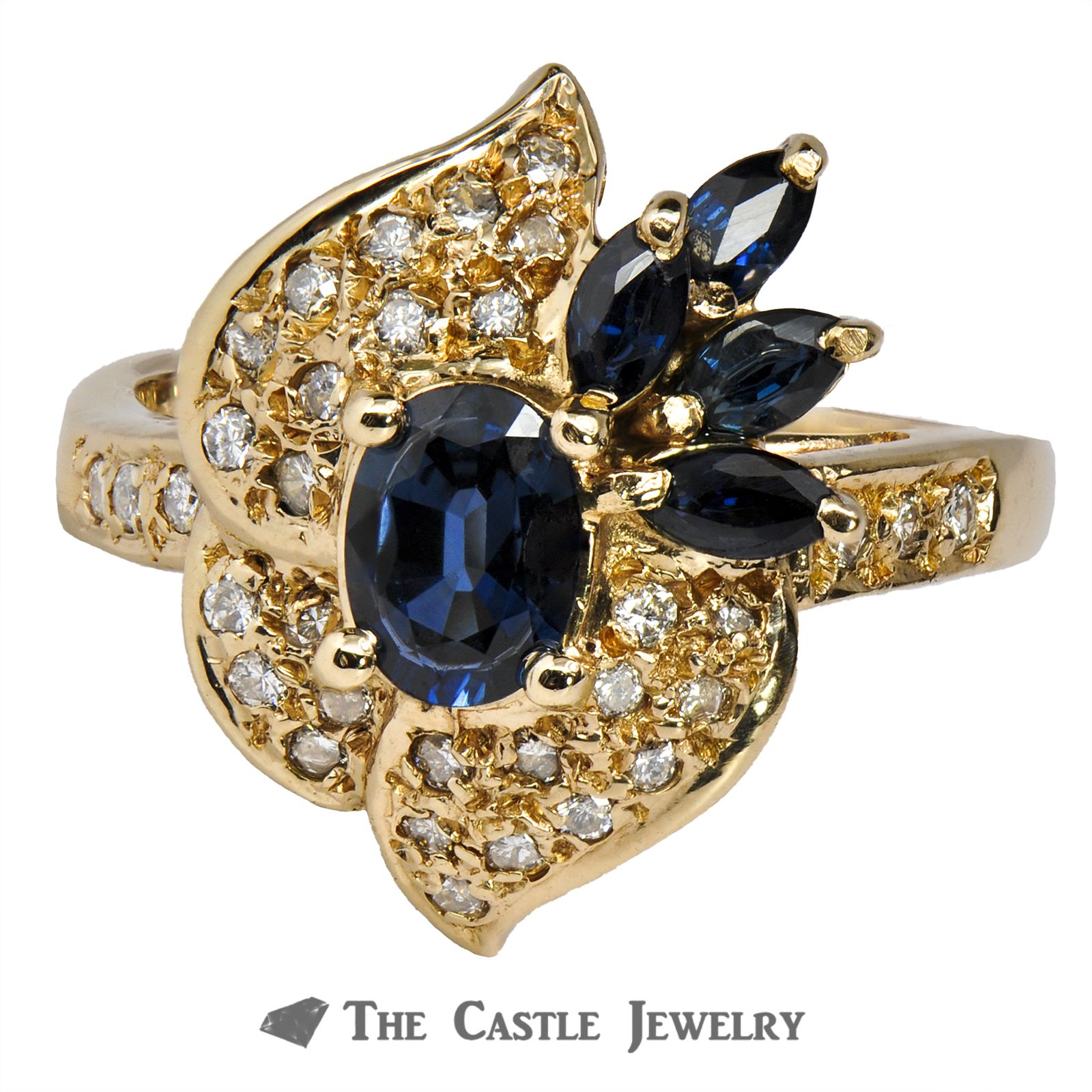 Oval Cut Blue Sapphire and Diamond Ring in 14K Yellow Gold