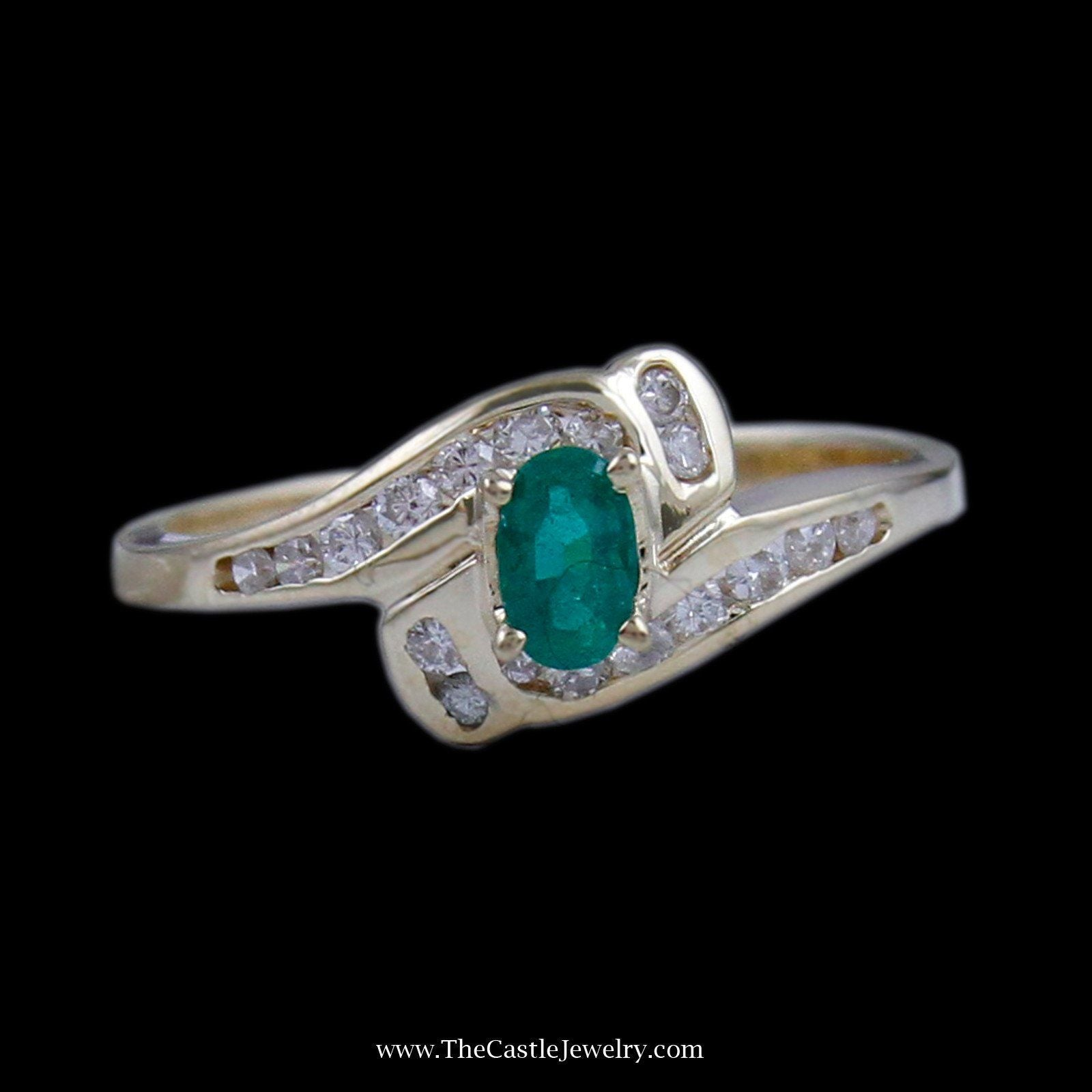 Beautiful Oval Emerald Ring in Bypass Diamond Mounting in 14K Yellow Gold