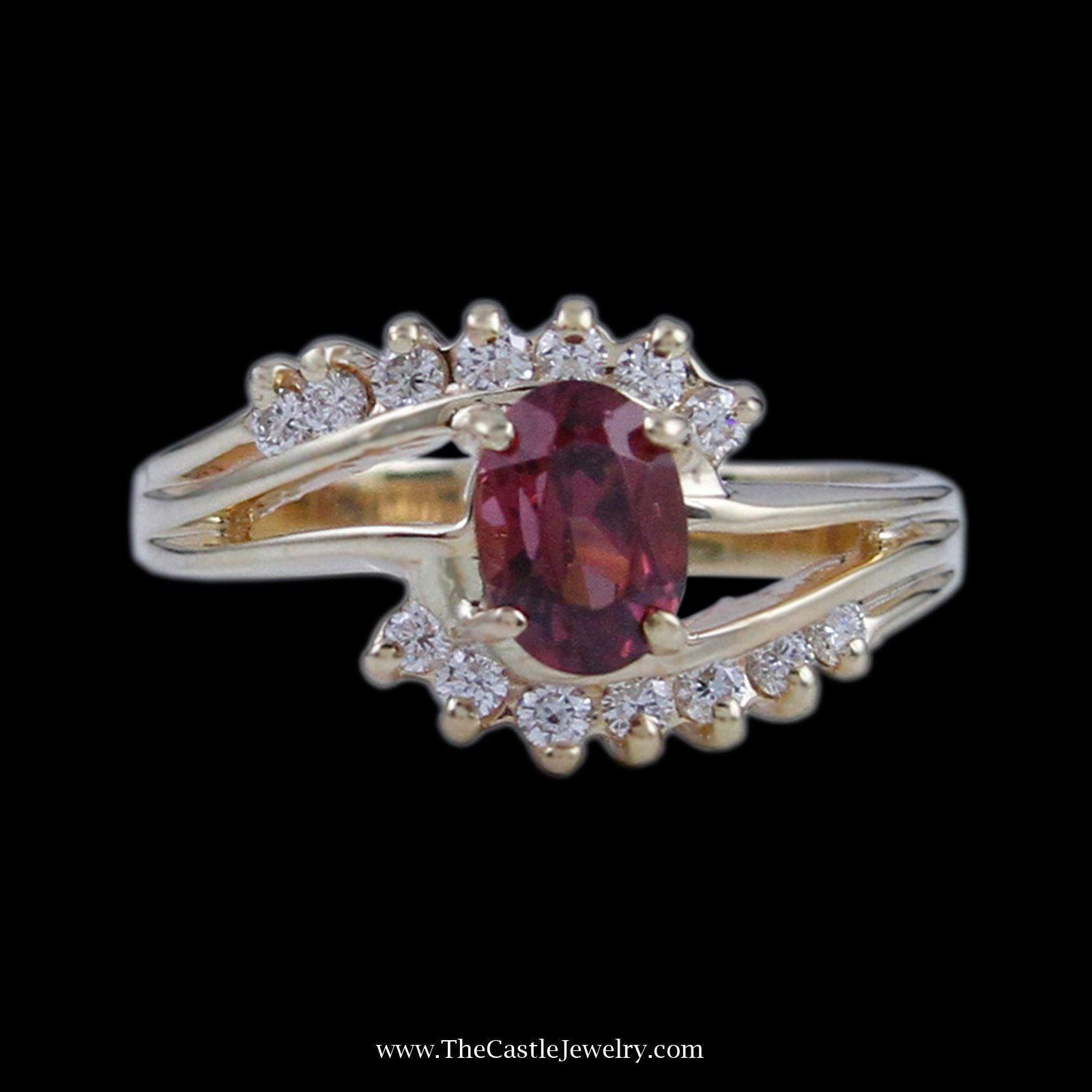 Gorgeous Oval Rhodolite Garnet Center with Prong Set Diamonds in Bypass Mounting