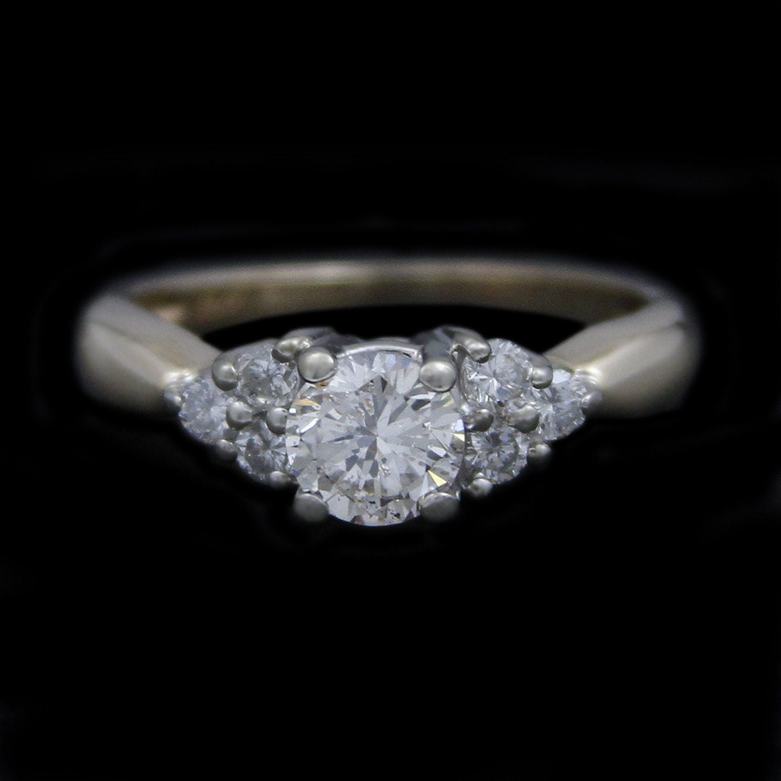 Round Brilliant Cut Diamond Engagement Ring with 3 Round Diamonds on Each Side