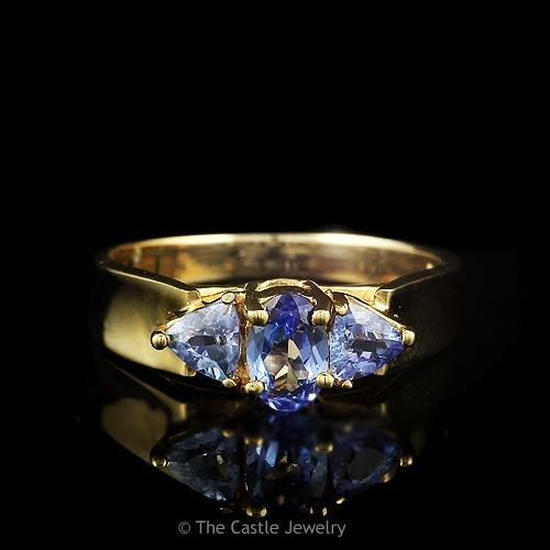 Oval Cut and Trillion Cut Tanzanite Ring in 14k Yellow Gold Cathedral Mounting