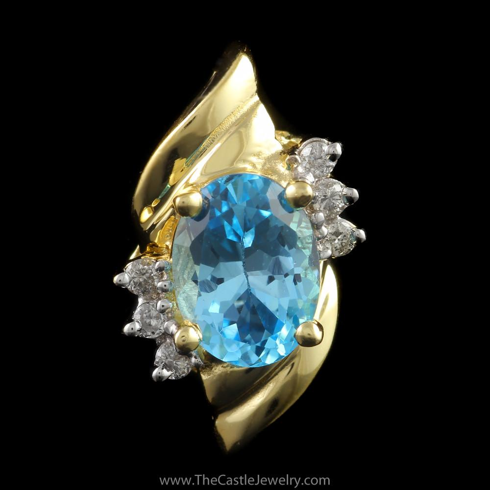 Oval Blue Topaz Pendant with Diamond Accents in 14K Yellow Gold