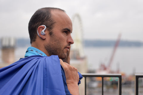 Landon Donovan wearing white JBuds Air Sport