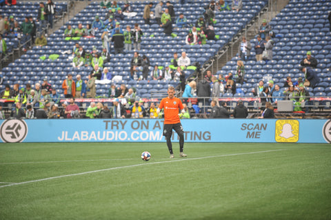 JLab Audio ad behind soccer player on field