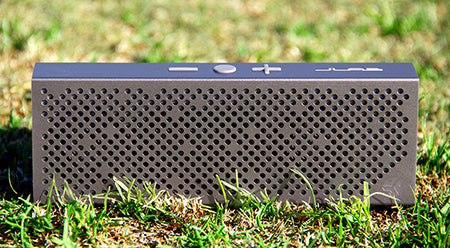 Front View of Gunmetal Crasher Slim Bluetooth Speaker in Grass
