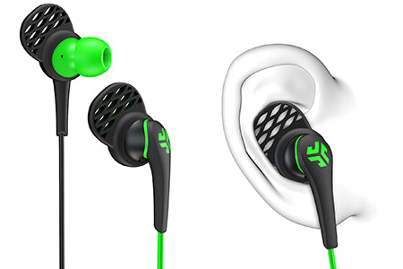 Close-up of Green and Black Core Custom Fit Earbuds with Cush Fins in Ear Diagram
