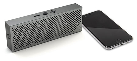 Top Down View of Gunmetal Crasher Slim Bluetooth Speaker and Phone