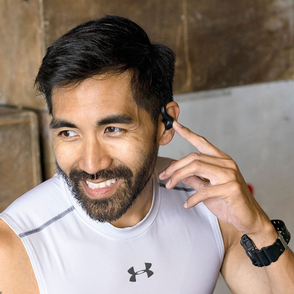 Guy wearing JBuds Air Sport True Wireless Earbuds