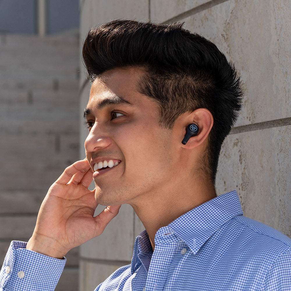 Side profile of man wearing JBuds Air Executive True Wireless Earbuds