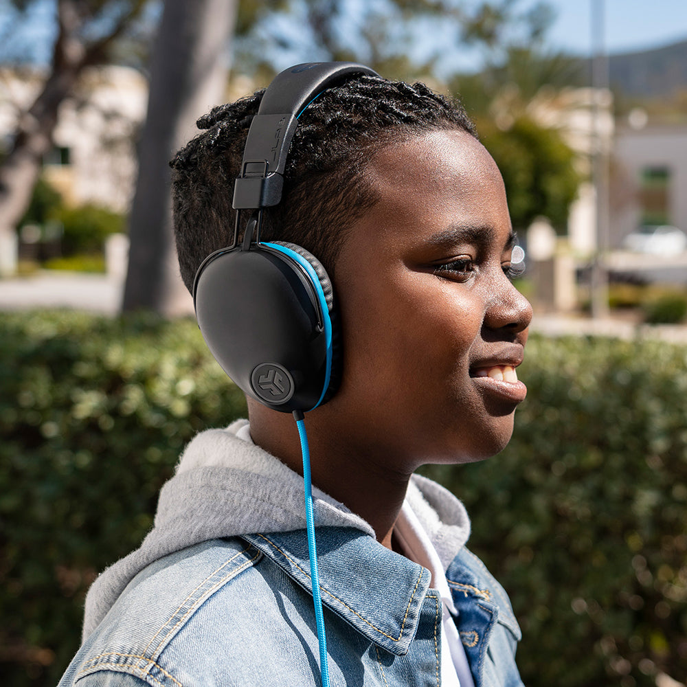 Boy wearing JBuddies Pro Over-Ear Headphones in Blue