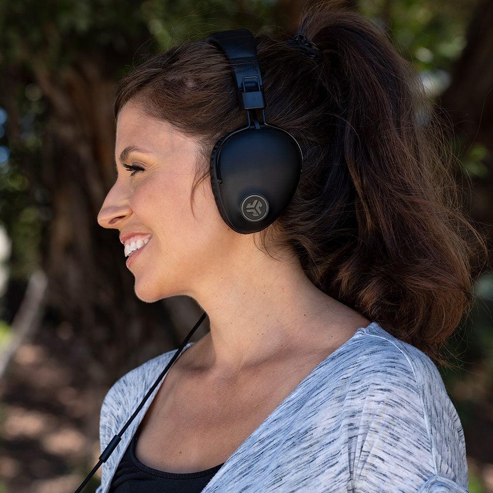 Woman wearing black Studio Pro Over-Ear Headphones