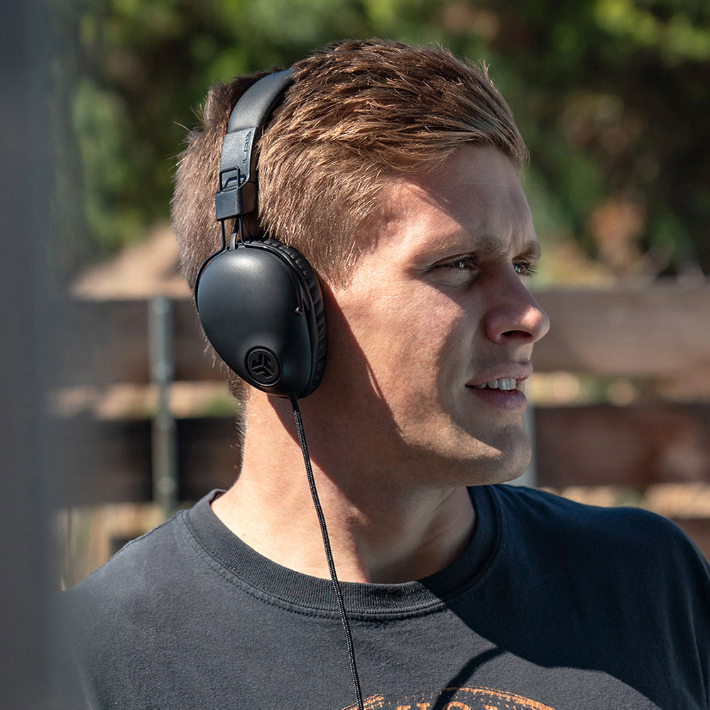 Young man wearing black Studio Pro Over-Ear Headphones