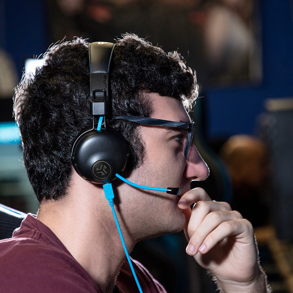 guy wearing play gamer headset