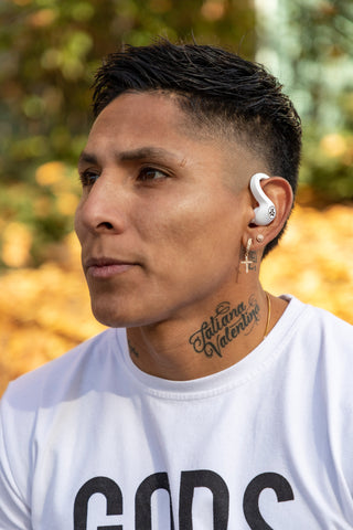 Raul Ruidiaz wearing JBuds Air Sport earbuds in white
