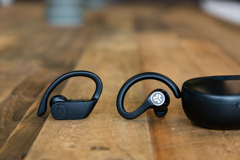 JBuds Air sport next to Powerbeats Pro