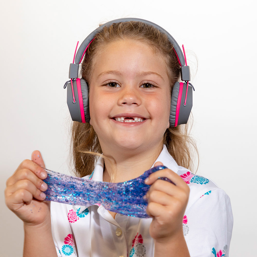 Boy wearing JBuddies Studio Bluetooth On-Ear Headphones in Blue
