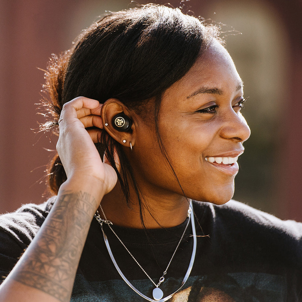 Woman wearing JBuds Air Icon True Wireless Earbuds