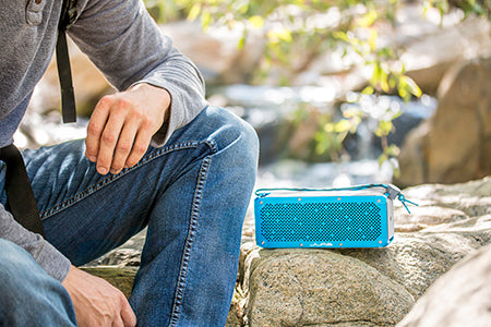 Blue Crasher XL Bluetooth Speaker Next to Man on Rock