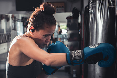 Woman Boxing Wearing Epic Air Elite Earbuds