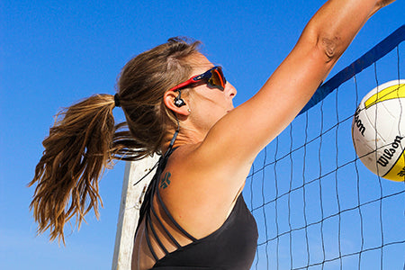Woman Playing Volleyball Wearing Black Epic2 Wireless Earbuds