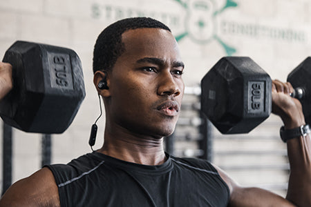 Guy wearing Fit Sport 3 Wireless Fitness Earbuds