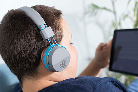 Boy wearing JBuddies Studio Bluetooth Over Ear Headphones in Blue