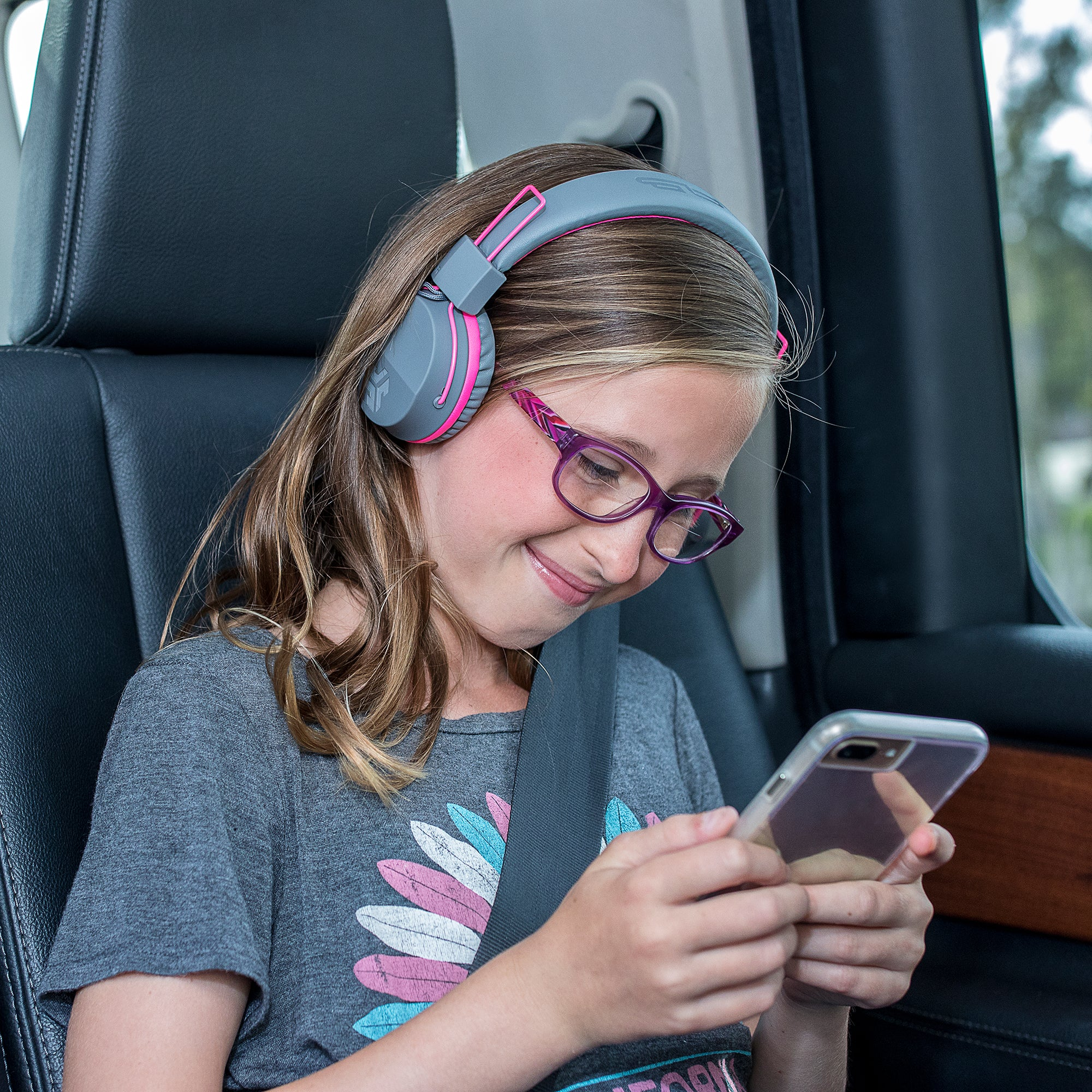 Girl wearing JBuddies Studio Bluetooth Over Ear Headphones in Pink