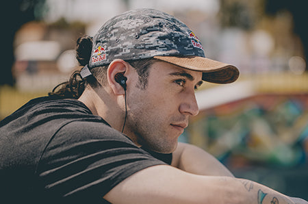 Guy wearing JBuds Pro Signature Earbuds